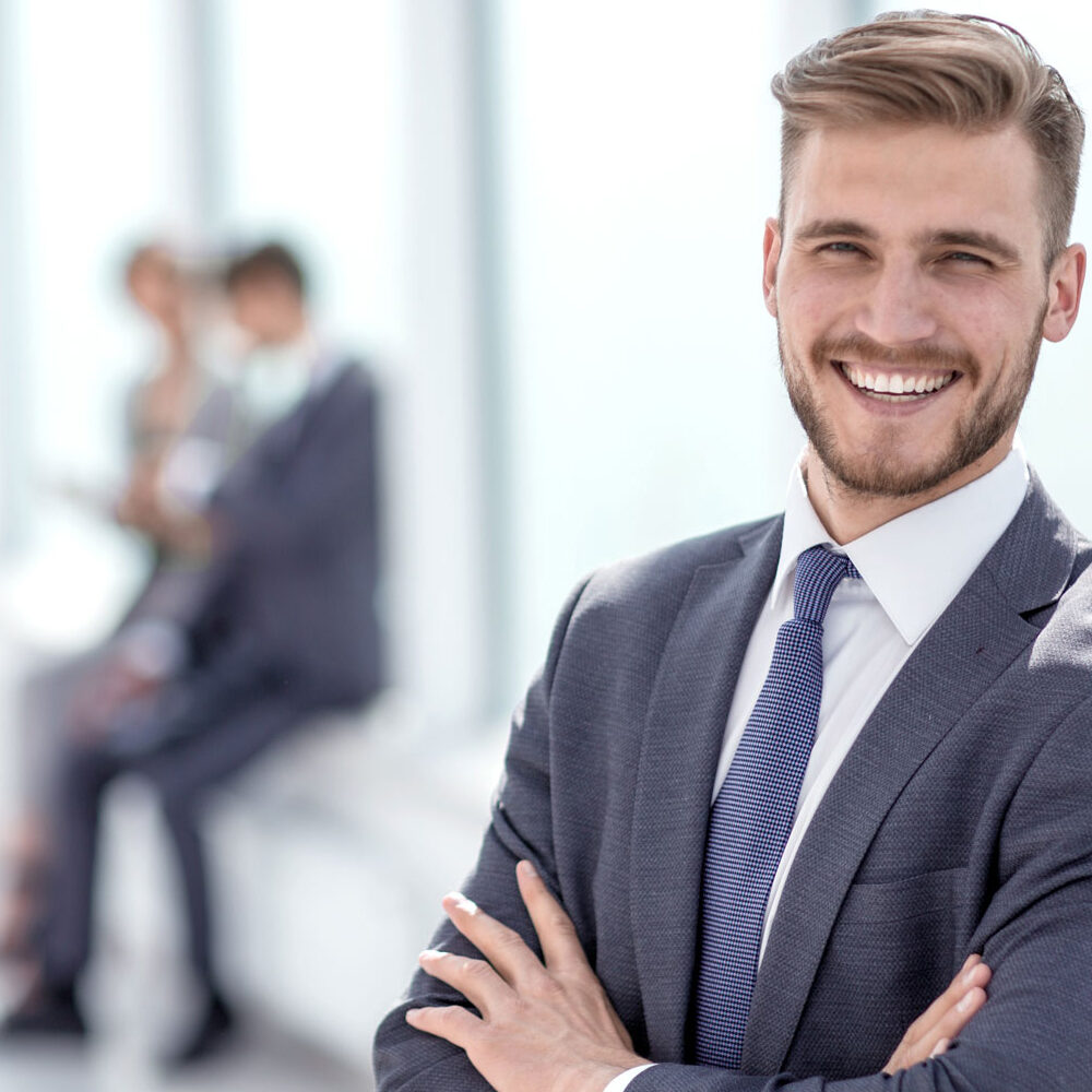 successful businessman on the background of a bright office.
